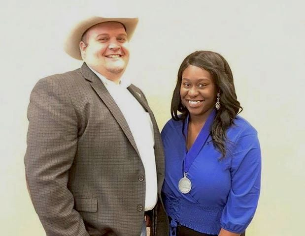Silver Spurs Riding Club Big Boss Dusty Holley with Silver Spurs Rodeo scholarship winner, Tamyia Paul