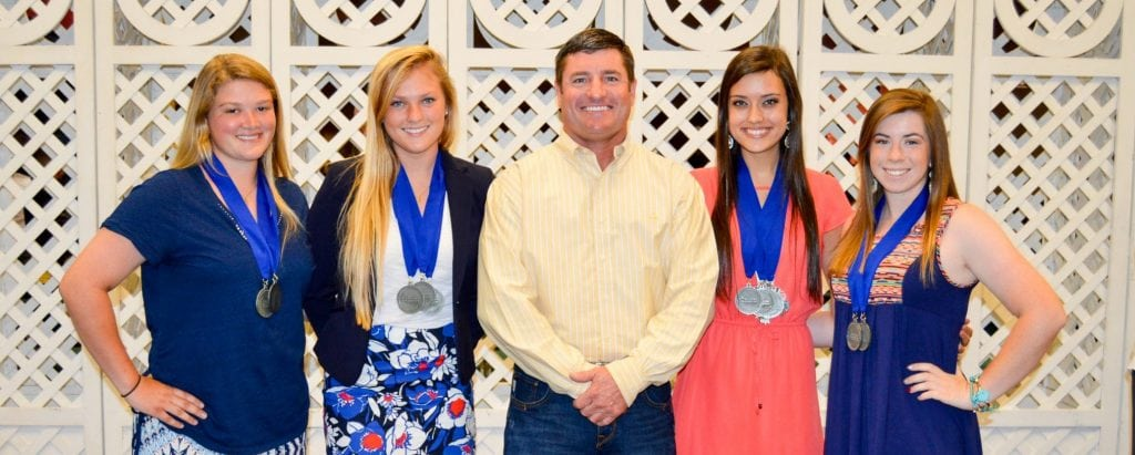 Silver Spurs Riding Club Big Boss Tim Shirah with 2015 scholarship recipients.