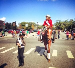 Rodeo queen on a horse in a parade