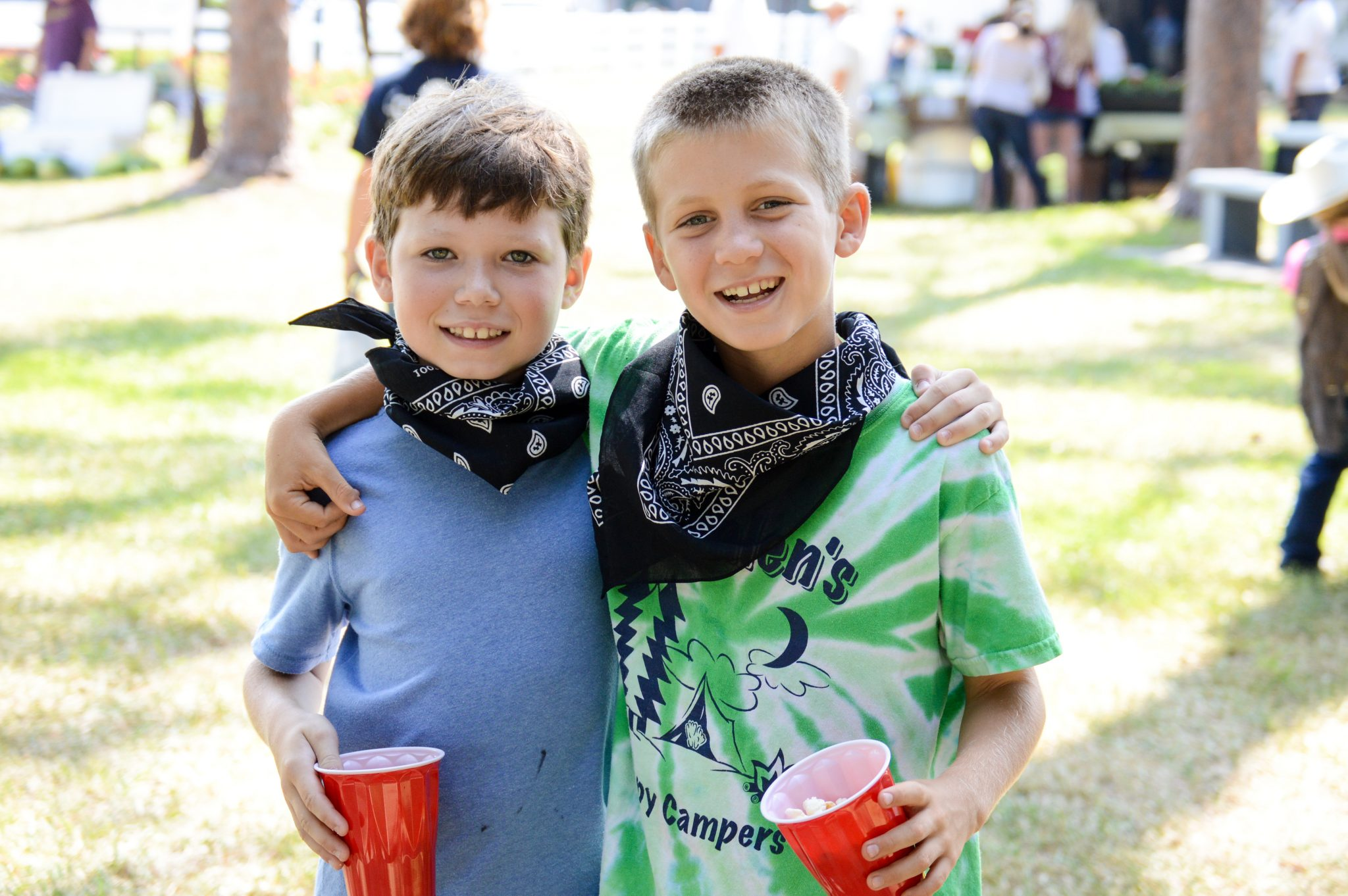 two rodeo friends side by side